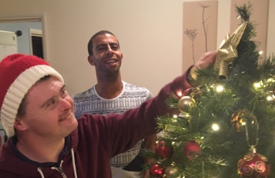 Diagrama Foundation: One of the Cabrini House residents putting the star on the Christmas tree.