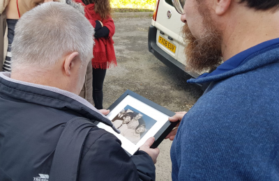Photos provide resident with snapshot from the past - david mcguire handing resident photograph