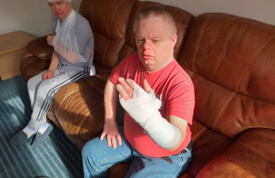 residents at Diagrama's care home Cabrini House pratice in first aid training