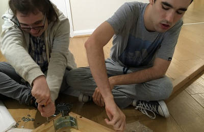 Diagrama Foundation Cabrini House residents assemble furniture for the Montessori activities