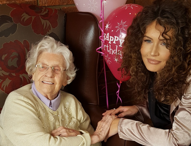 Sue Bartholomey celebrates her 100th birthday with her granddaughter Zara Newfield