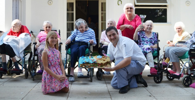 Diagrama Foundation: Edensor chef Victor Albescu with staff, residents and supporters