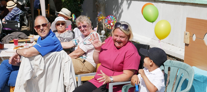 Staff, residents and their families enjoy the summer fete at Edensor Care Centre